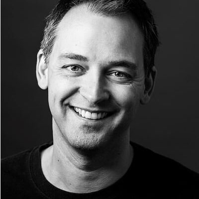 Black and white headshot of Marcus Kyd.
